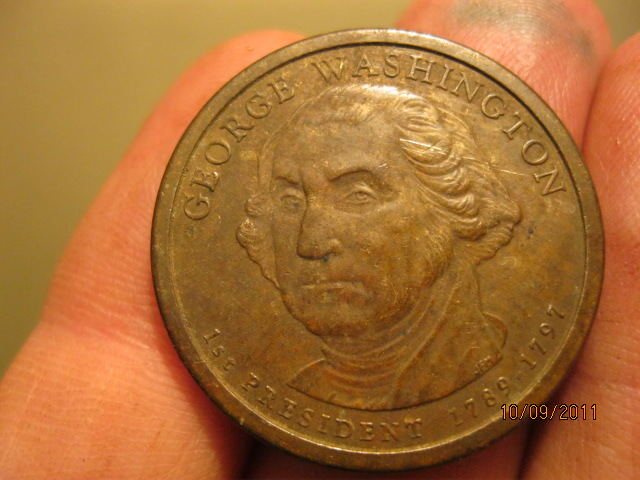 First Dollar Coin Image